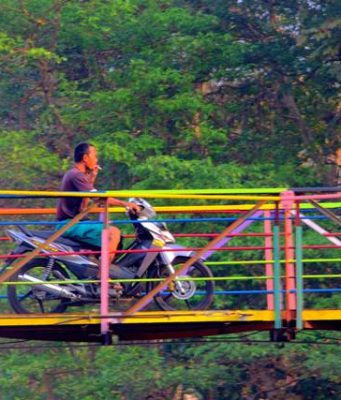 colorful suspension bridge between Sempur and Lebak Kantin a